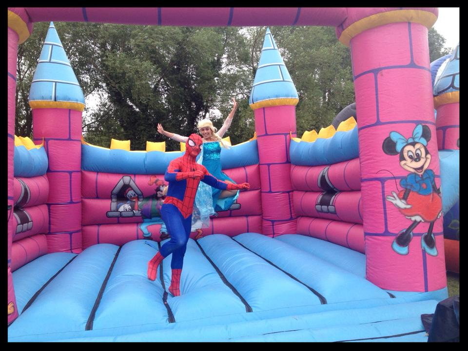 Spider Man and Queen Elsa on the Bouncy Castle as Rainbows Hospice