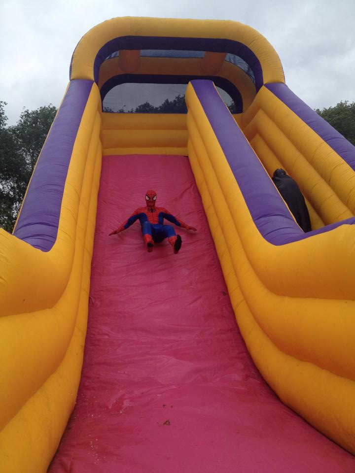 Spider Man on the inflatable slide - Rainbows Hospice
